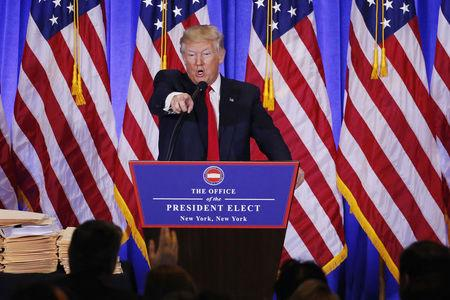 U.S. President-elect Donald Trump argues with CNN's Jim Acosta during a news conference in the lobby of Trump Tower in Manhattan, New York City