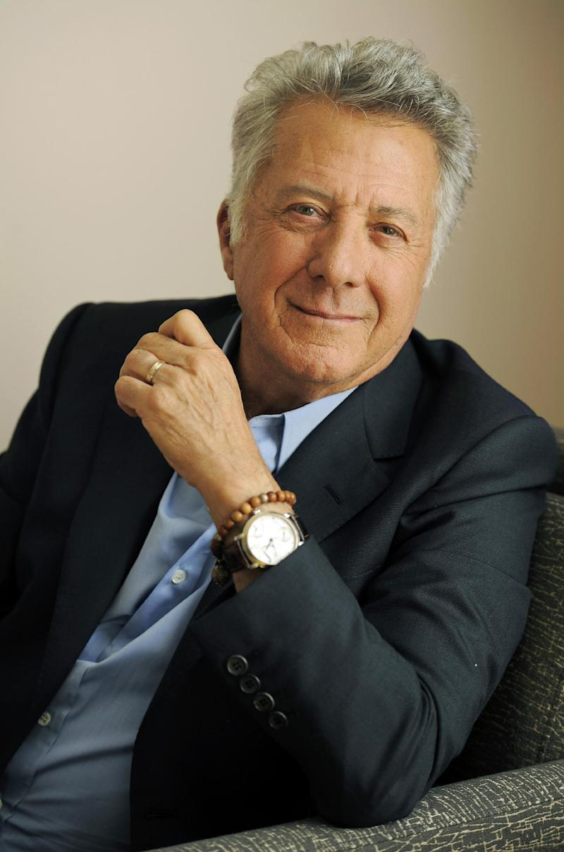 """FILE - In this Sept. 10, 2012 file photo, Dustin Hoffman, director of the film """"Quartet,"""" poses for a portrait at the 2012 Toronto Film Festival, in Toronto.  The 75-year-old Hoffman went behind the camera for """"Quartet,"""" starring Maggie Smith, Tom Courtenay, Billy Connolly and Pauline Collins as aging British opera divas at a retirement home for musicians who put aside past differences for a reunion concert. (Photo by Chris Pizzello/Invision/AP, File)"""