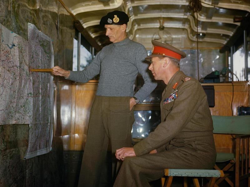Field Marshal Sir Bernard Montgomery explaining Allied strategy to King George VI in his command caravan in Holland, October 1944 (Imperial War Museum )