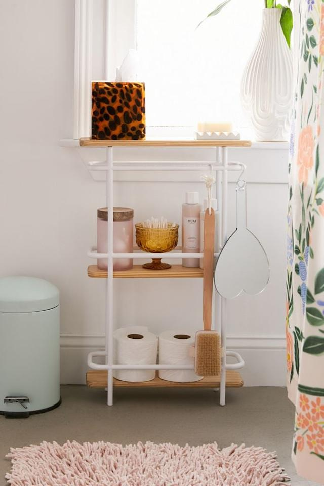 """<p>We love that this <a href=""""https://www.popsugar.com/buy/Shelby-Bathroom-Storage-Shelf-558820?p_name=Shelby%20Bathroom%20Storage%20Shelf&retailer=urbanoutfitters.com&pid=558820&price=89&evar1=casa%3Aus&evar9=47326714&evar98=https%3A%2F%2Fwww.popsugar.com%2Fhome%2Fphoto-gallery%2F47326714%2Fimage%2F47328048%2FShelby-Bathroom-Storage-Shelf&list1=shopping%2Curban%20outfitters%2Corganization%2Cbathrooms%2Chome%20organization%2Chome%20shopping&prop13=api&pdata=1"""" rel=""""nofollow"""" data-shoppable-link=""""1"""" target=""""_blank"""" class=""""ga-track"""" data-ga-category=""""Related"""" data-ga-label=""""https://www.urbanoutfitters.com/shop/shelby-bathroom-storage-shelf?category=bathroom-shelving-storage&amp;color=010&amp;type=REGULAR&amp;size=ONE%20SIZE&amp;quantity=1"""" data-ga-action=""""In-Line Links"""">Shelby Bathroom Storage Shelf</a> ($89) has hanging hooks too.</p>"""