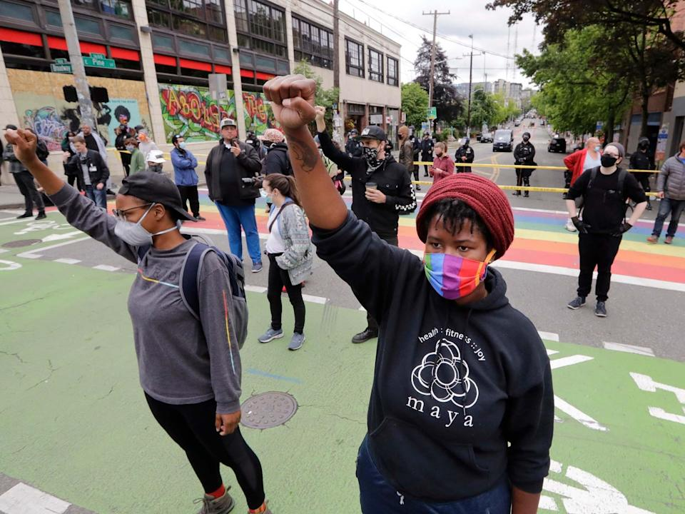 Independent correspondent Andrew Buncombe was arrested while filming police clearing out the protest zone known as Chop in Seattle this week (AP)