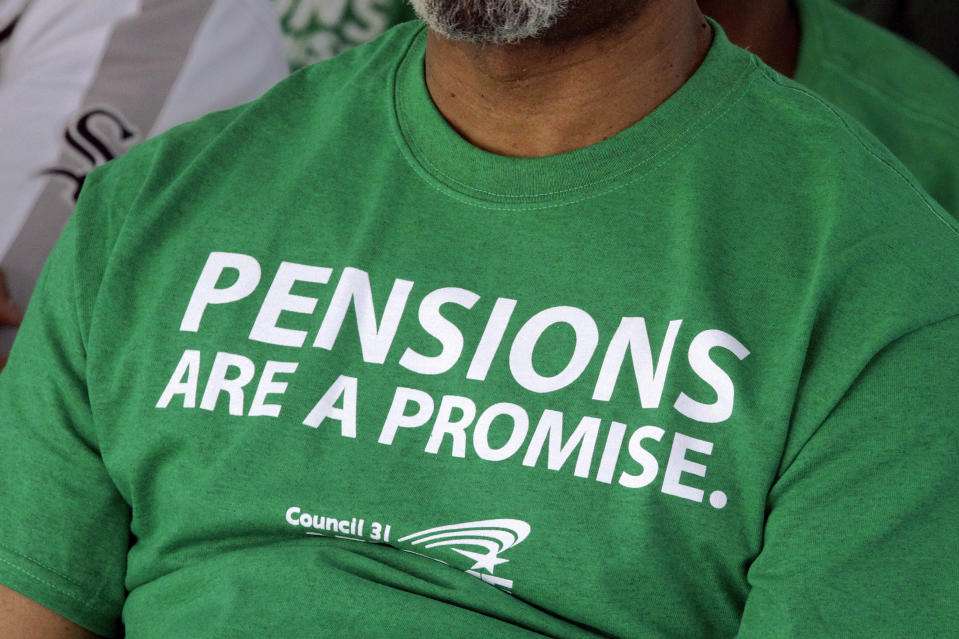 In this photo taken May 2012 an American Federation of State County and Municipal Employees union member wears their protest message on his shirt while rallying against the proposed pension legislation at the Illinois State Capitol in Springfield, Ill. The Pew Center on the States releases a 50-state report that finds the gap between the promises states have made for public employees' retirement benefits and the money they have set aside has grown. (AP Photo/Seth Perlman)