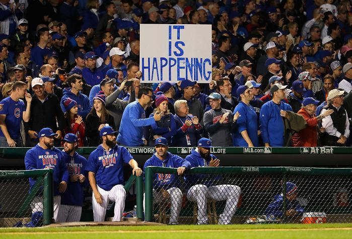 Fans hold up a sign during game six of the National League Championship Series at Wrigley Field. (Getty Images)