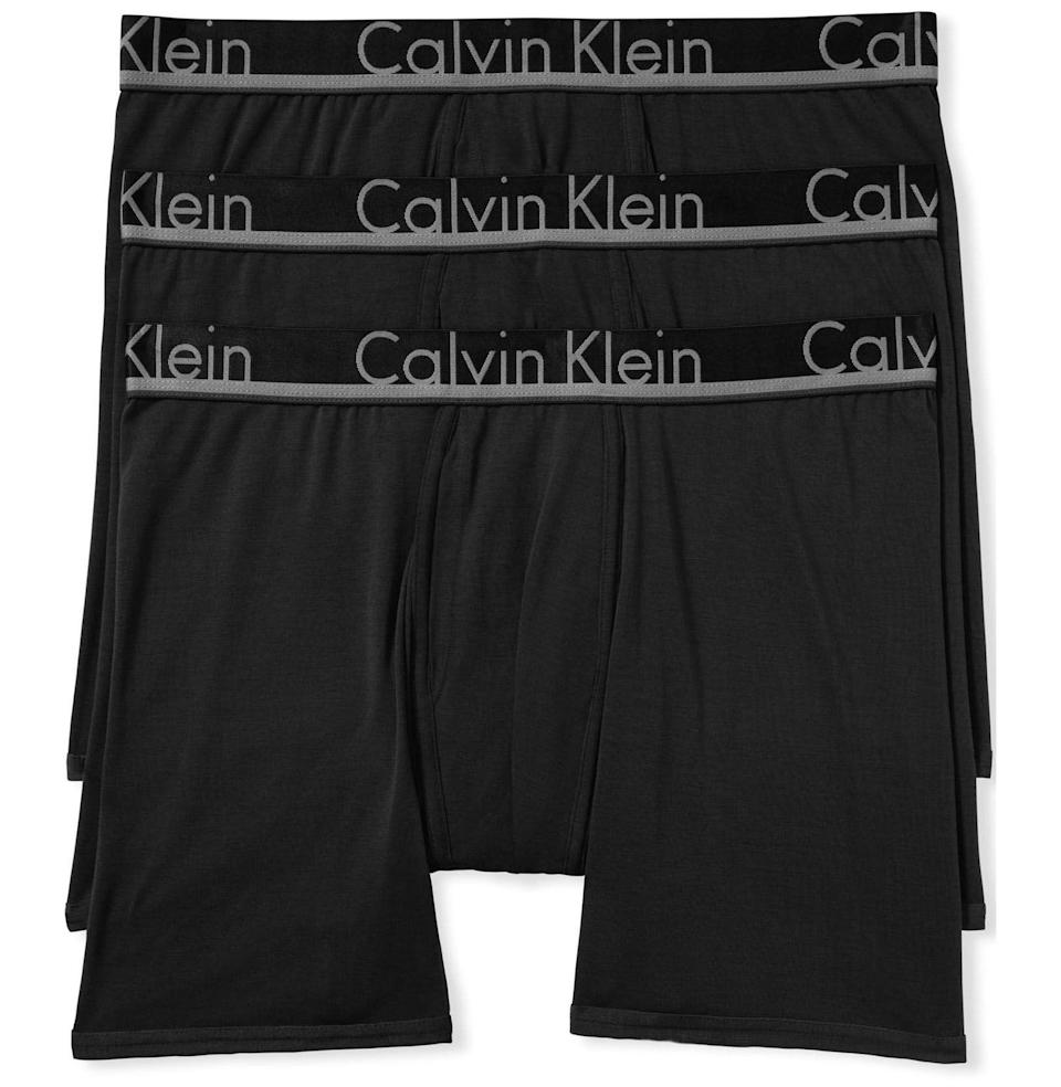 """<p><strong>Calvin Klein</strong></p><p>amazon.com</p><p><strong>$58.99</strong></p><p><a href=""""https://www.amazon.com/Calvin-Klein-Underwear-Modal-Briefs/dp/B072M3B81K?tag=syn-yahoo-20&ascsubtag=%5Bartid%7C10054.g.22141607%5Bsrc%7Cyahoo-us"""" rel=""""nofollow noopener"""" target=""""_blank"""" data-ylk=""""slk:Buy"""" class=""""link rapid-noclick-resp"""">Buy</a></p><p>You can't beat Calvins. This three-pack gives him a few days' worth in classic black.</p>"""