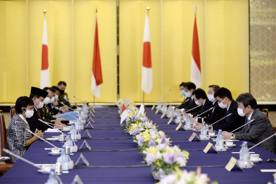 Indonesian Foreign Minister Retno Marsudi, left, and Indonesian Defense Minister Prabowo Subianto, second left, hold a talk with Toshimitsu Motegi, Japan's foreign minister, right, and Japanese Defense Minister Kishi Nobuo, second from right, at the start of the two-plus-two Foreign and Defense Ministers meeting between Japan and Indonesia Tuesday, March 30, 2021 at the Iikura Guesthouse of the Foreign Ministry in Tokyo, Japan.(David Mareuil/Pool Photo via AP)
