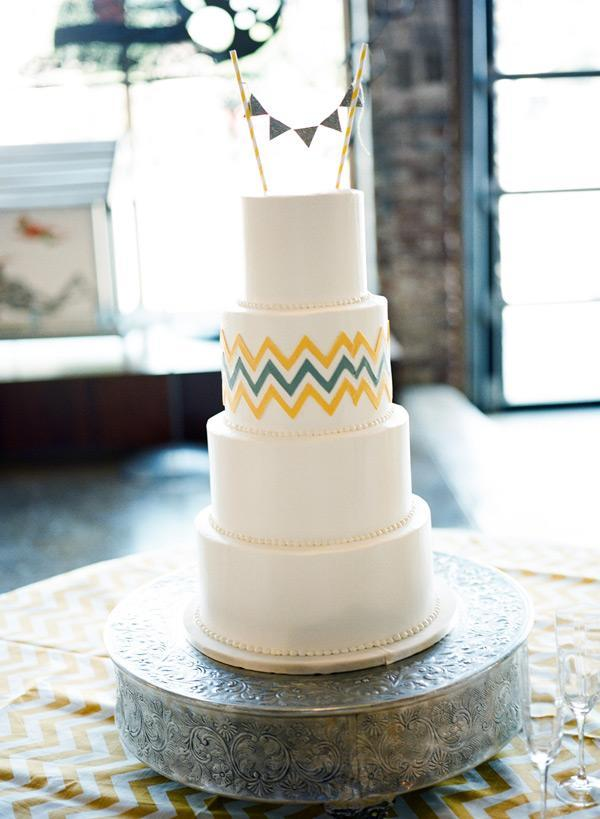 """<div class=""""caption-credit""""> Photo by: Stephen DeVries Photography</div>The fun topper and simple chevron pattern make this cake memorable. <br> <br> <a href=""""http://lover.ly/search?e=0&q=blue+and+yellow&utm_source=shine2-7-13chevron&utm_medium=guest&utm_campaign=shine2-7-13chevron"""" rel=""""nofollow noopener"""" target=""""_blank"""" data-ylk=""""slk:Blue and yellow: a perfect wedding pair"""" class=""""link rapid-noclick-resp"""">Blue and yellow: a perfect wedding pair</a> <br> <br> Photo by: <a href=""""http://www.stephendevriesweddings.com/"""" rel=""""nofollow noopener"""" target=""""_blank"""" data-ylk=""""slk:Stephen DeVries Photography"""" class=""""link rapid-noclick-resp"""">Stephen DeVries Photography</a> on <a href=""""http://iloveswmag.com/2012/05/22/chevron-birmingham-wedding-by-stephen-devries-photography/"""" rel=""""nofollow noopener"""" target=""""_blank"""" data-ylk=""""slk:Southern Weddings"""" class=""""link rapid-noclick-resp"""">Southern Weddings</a> via <a href=""""http://lover.ly/image/134838"""" rel=""""nofollow noopener"""" target=""""_blank"""" data-ylk=""""slk:Lover.ly"""" class=""""link rapid-noclick-resp"""">Lover.ly</a> <br> <br>"""