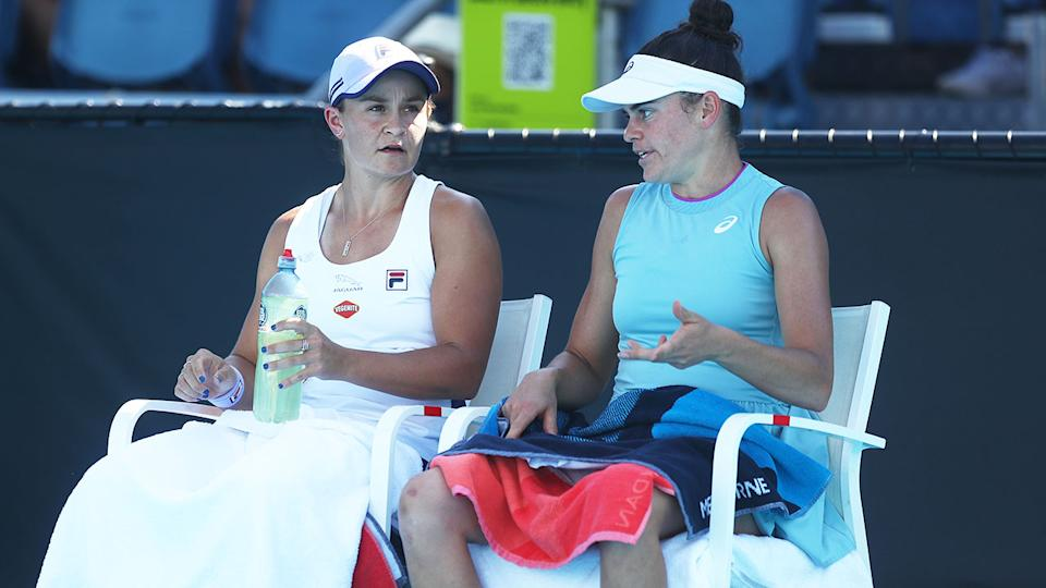 Seen here, Australian Open doubles partner Ash Barty and Jennifer Brady have a chat during a break in their match.