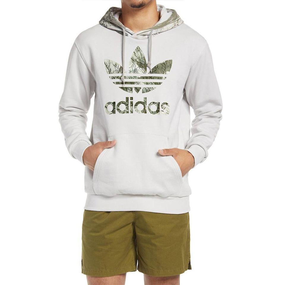 """<p><strong>ADIDAS ORIGINALS</strong></p><p>nordstrom.com</p><p><a href=""""https://go.redirectingat.com?id=74968X1596630&url=https%3A%2F%2Fwww.nordstrom.com%2Fs%2Fadidas-originals-camo-hoodie%2F5505719&sref=https%3A%2F%2Fwww.menshealth.com%2Fstyle%2Fg33510339%2Fnordstrom-anniversary-sale-2020%2F"""" rel=""""nofollow noopener"""" target=""""_blank"""" data-ylk=""""slk:BUY IT HERE"""" class=""""link rapid-noclick-resp"""">BUY IT HERE </a></p><p><strong><del>$65 </del>$42.90 (33% off) </strong></p><p>Take your love of Adidas beyond your sneaker collection with this camo hoodie. After all, who isn't living in their sweats these days? </p>"""