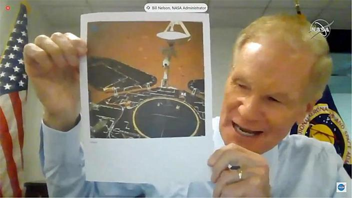 New NASA Administrator Bill Nelson holds up a photo taken by China's Zhurong Mars lander, telling lawmakers the agency needs sustained funding in the face of increased competition in space. / Credit: NASA TV