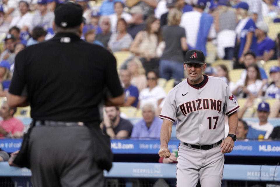 Arizona Diamondbacks manager Torey Lovullo, right, questions home plate umpire Tony Randazzo about a strikeout call during the first inning of a baseball game against the Los Angeles Dodgers Saturday, July 10, 2021, in Los Angeles. (AP Photo/Mark J. Terrill)