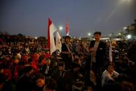 FILE PHOTO: University students protest outside the Indonesian Parliament in Jakarta
