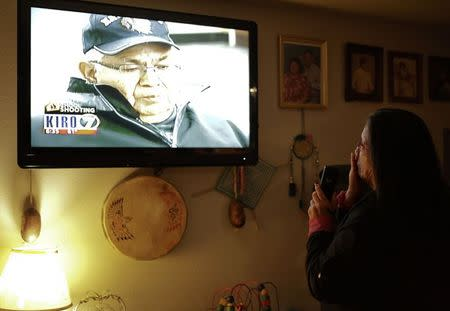 Paula Hatch gets chocked up as she watches an interview with her father, Don Hatch, Jr., on the news the day after several family relatives were involved in a shooting at Marysville-Pilchuck High School in Marysville, Washington October 25, 2014. REUTERS/Jason Redmond