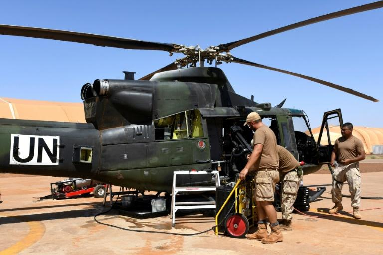 Canadian UN peacekeeping soldiers work on an helicopter at the Castors Camp in Gao, Mali