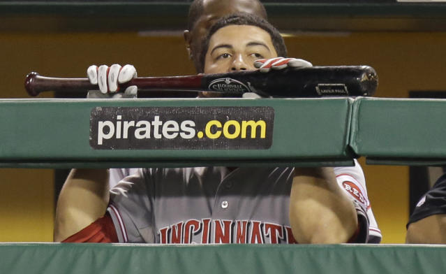 Cincinnati Reds' Xavier Paul holds his bat as his team bats in the ninth inning against the Pittsburgh Pirates in the NL wild-card playoff baseball game on Tuesday, Oct. 1, 2013, in Pittsburgh. (AP Photo/Gene J. Puskar)