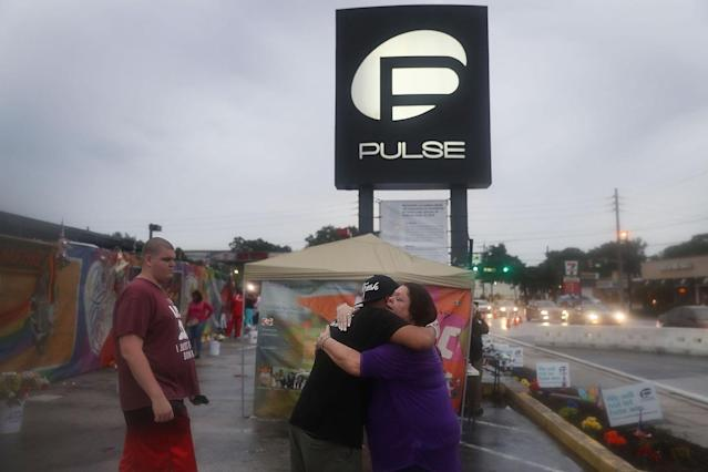 <p>Neema Bahrami and Jacque Azevrdo (L-R) hug outside the Pulse gay nightclub one day before the one year anniversary of the shooting on June 11, 2017 in Orlando, Florida. (Joe Raedle/Getty Images) </p>