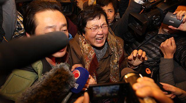 A relative of a passenger onboard Malaysia Airlines flight MH370 cries at Lidu Hotel in Beijing. Photo: Getty Images
