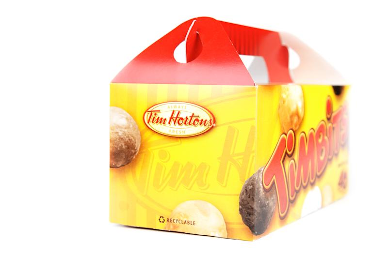 A box of Tim Hortons timbits sits isolated on a white background.