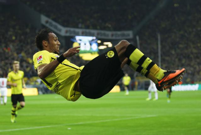 Borussia Dortmund's Pierre-Emerick Aubameyang celebrates a goal against Hamburg SV during the German first division Bundesliga soccer match in Dortmund September 14, 2013. REUTERS/Ina Fassbender (GERMANY - Tags: SPORT SOCCER) DFL RULES TO LIMIT THE ONLINE USAGE DURING MATCH TIME TO 15 PICTURES PER GAME. IMAGE SEQUENCES TO SIMULATE VIDEO IS NOT ALLOWED AT ANY TIME. FOR FURTHER QUERIES PLEASE CONTACT DFL DIRECTLY AT + 49 69 650050