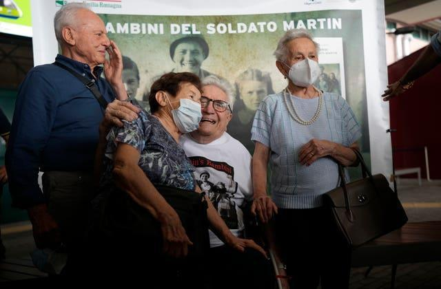 Martin Adler with the siblings he is credited with saving
