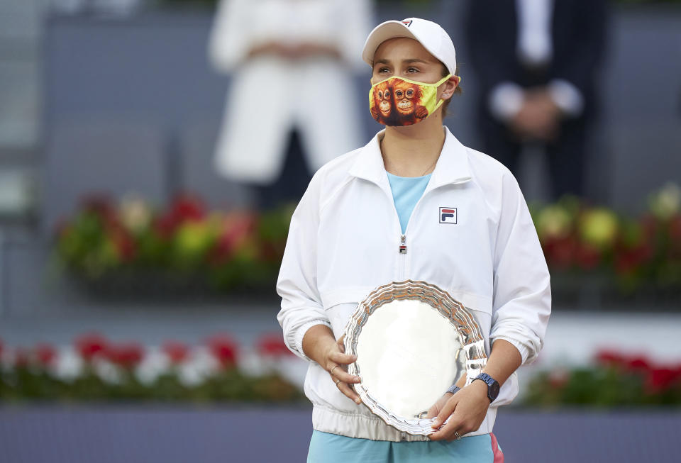 Ash Barty (pictured) holding her trophy at the Madrid Open.