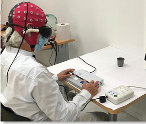 Blind patient during extracranial multi-channel electroencephalography (EEG) recording.