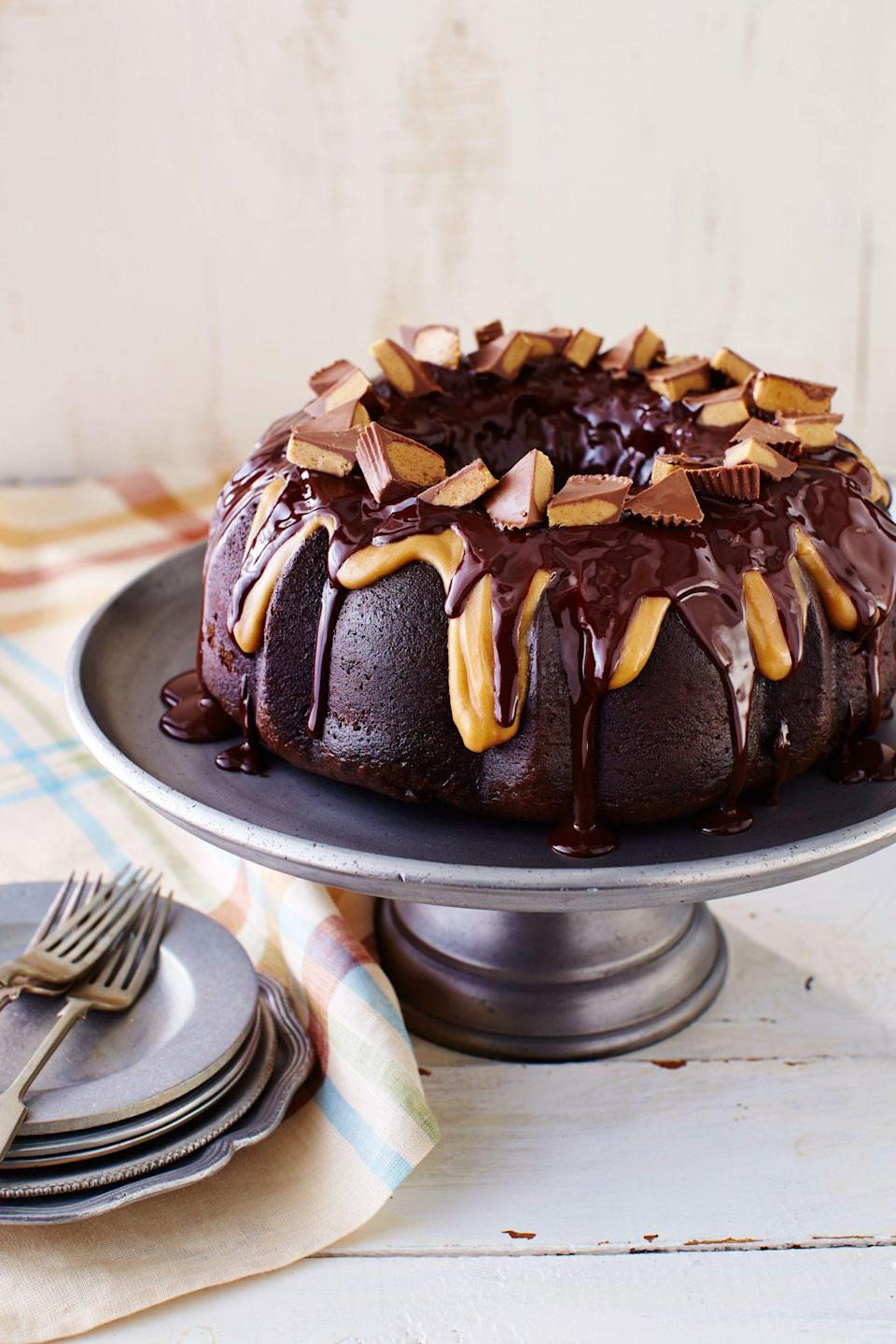 """<p><strong>Recipe: <a href=""""https://www.southernliving.com/recipes/reeses-cake"""" rel=""""nofollow noopener"""" target=""""_blank"""" data-ylk=""""slk:Reese's Cake"""" class=""""link rapid-noclick-resp"""">Reese's Cake</a></strong></p> <p>Leftover Halloween candy? Make this totally decadent cake its new home. This divine cake starts with boxed mix, so even the littlest helpers in your house can get in on the baking fun.</p>"""