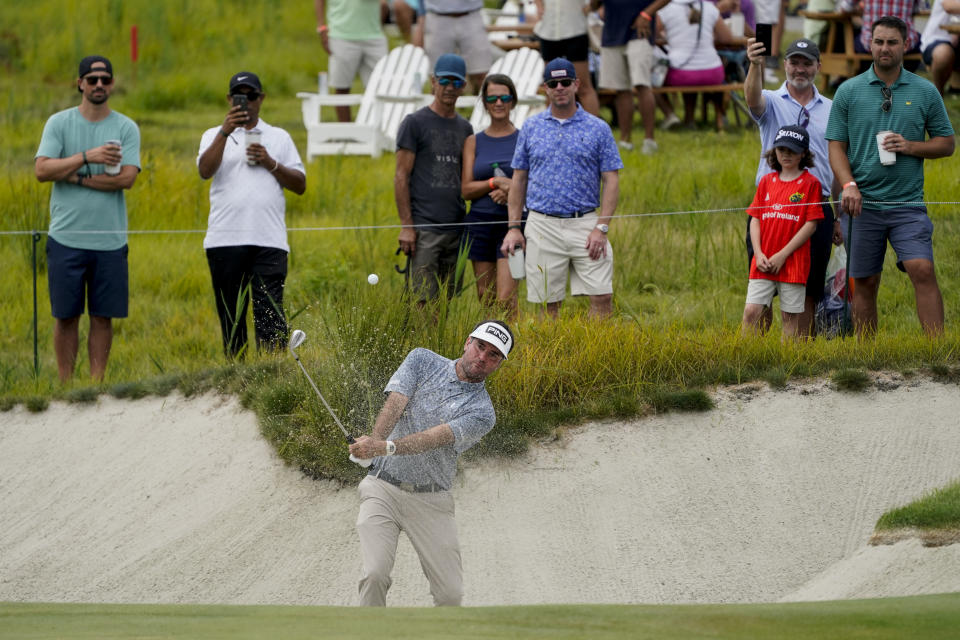 Bubba Watson hits from a sand trap onto the 13th green in the second round at the Northern Trust golf tournament, Friday, Aug. 20, 2021, at Liberty National Golf Course in Jersey City, N.J. (AP Photo/John Minchillo)