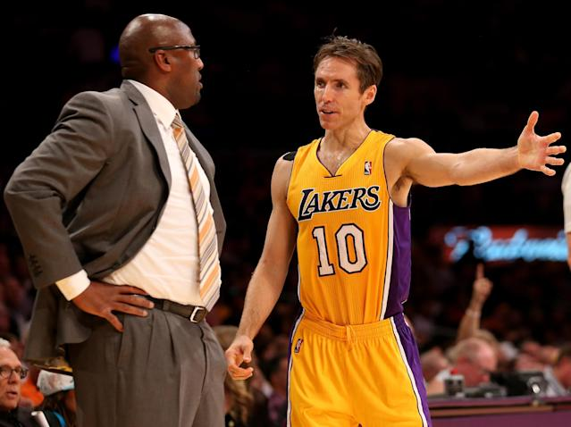 LOS ANGELES, CA - OCTOBER 30: Head coach Mike Brown of the Los Angeles Lakers confers with Steve Nash #10 in the game with the Dallas Mavericks at Staples Center on October 30, 2012 in Los Angeles, California. The Mavericks won 99-91. NOTE TO USER: User expressly acknowledges and agrees that, by downloading and or using this photograph, User is consenting to the terms and conditions of the Getty Images License Agreement. (Photo by Stephen Dunn/Getty Images)) (Photo by Stephen Dunn/Getty Images)