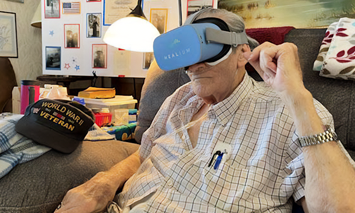 World War II veteran JD Sinclair experiencing a VR visit to war memorials in the Nation's Capital. The rural Missouri man was a Seaman 2nd Class during WWII stationed aboard the USS Columbia in the North Atlantic.