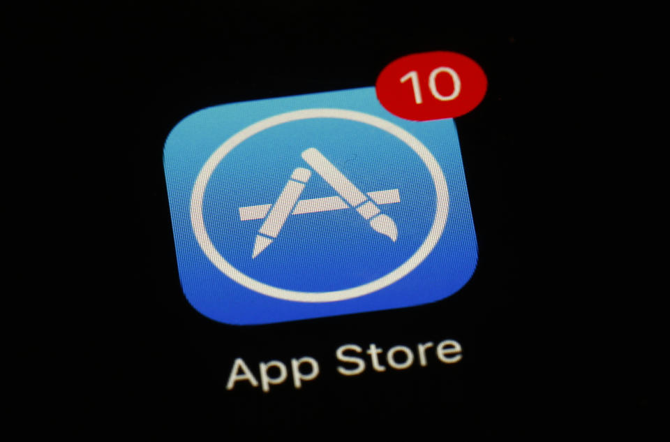 "FILE - This March 19, 2018, file photo shows Apple's App Store app in Baltimore. Apple has dropped the hugely popular ""Fortnite"" game from its App Store after the game's developer introduced a direct payment plan that bypasses Apple's platform. Its developer, Epic Games, said in a blog post Thursday, Aug. 13, 2020, that it was introducing Epic Direct payments, a direct payment plan for Apple's iOS and Google Play. (AP Photo/Patrick Semansky, File)"