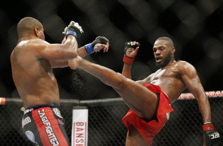 In their one fight, Jon Jones (right) defeated Daniel Cormier via a unanimous decision in 2015. (AP)