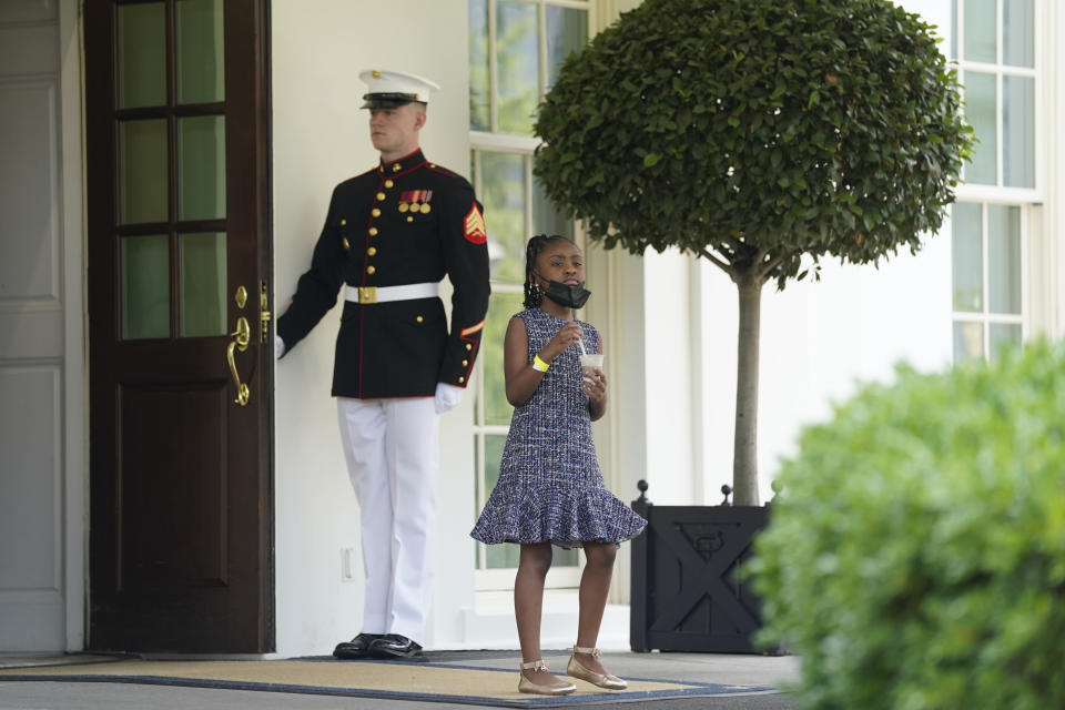 Gianna Floyd, the daughter of George Floyd, walks out of the West Wing door at the White House, Tuesday, May 25, 2021, in Washington. (AP Photo/Evan Vucci)