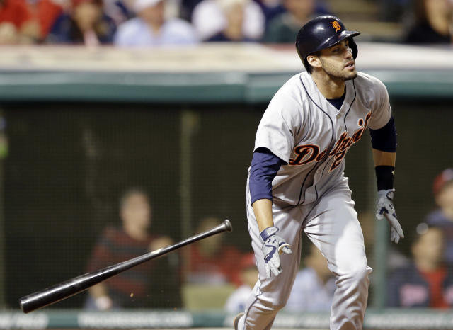 Detroit Tigers' J.D. Martinez watches his ball after hitting a three-run home run off Cleveland Indians relief pitcher John Axford in the eighth inning of a baseball game on Friday, June 20, 2014, in Cleveland. Tigers' Miguel Cabrera and Victor Martinez also scored on the hit. (AP Photo/Tony Dejak)