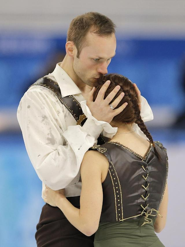 Maylin Wende and Daniel Wende of Germany embrace after competing in the pairs free skate figure skating competition at the Iceberg Skating Palace during the 2014 Winter Olympics, Wednesday, Feb. 12, 2014, in Sochi, Russia. (AP Photo/Vadim Ghirda)