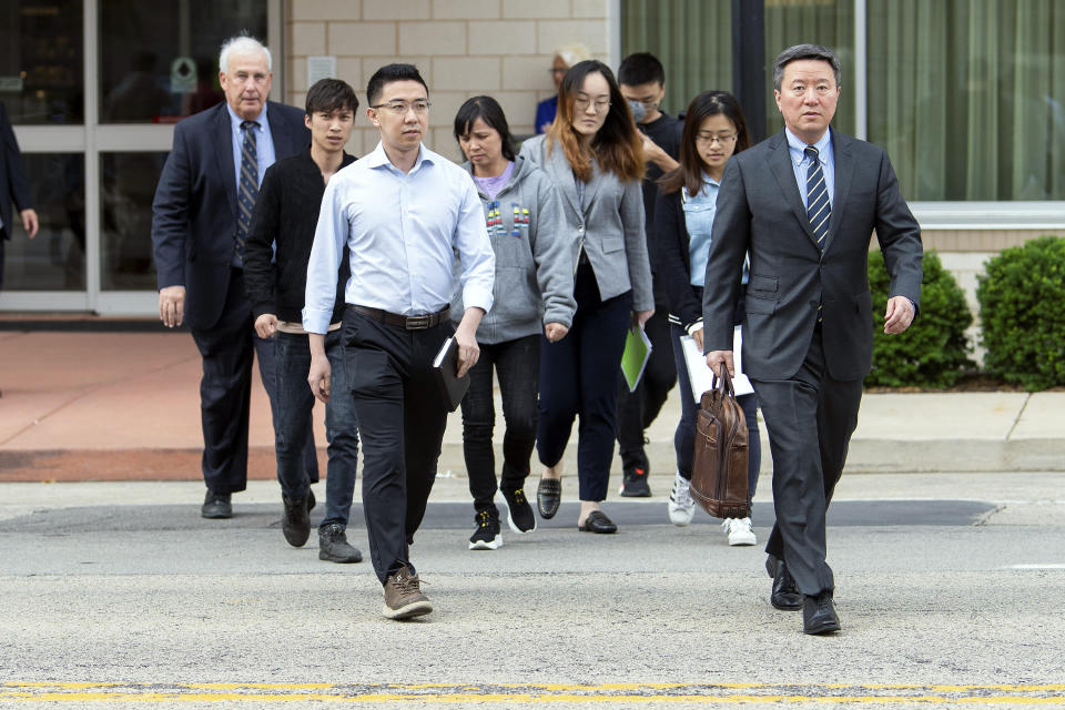 Members of visiting University of Illinois scholar Yingying Zhang's family walk with lawyers outside of the Federal Building and U.S. Courthouse Wednesday, June 12, 2019, in Peoria, Ill., before the trial of Brendt Christensen. (Stephen Haas/The News-Gazette via AP)