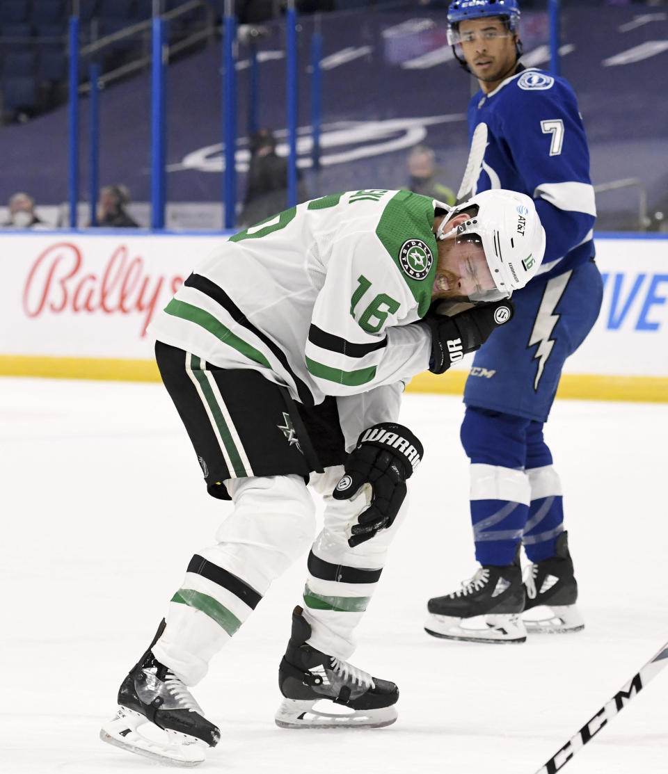 Dallas Stars center Joe Pavelski (16) heads to the bench after being hit by the puck during the first period of the team's NHL hockey game against the Tampa Bay Lightning on Friday, May 7, 2021, in Tampa, Fla. (AP Photo/Jason Behnken)