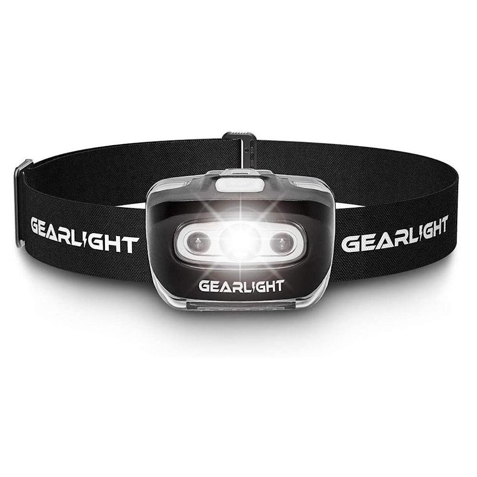 """<p><strong>GearLight</strong></p><p>amazon.com</p><p><strong>$15.99</strong></p><p><a href=""""https://www.amazon.com/dp/B07QGRWZNB?tag=syn-yahoo-20&ascsubtag=%5Bartid%7C2141.g.32869392%5Bsrc%7Cyahoo-us"""" rel=""""nofollow noopener"""" target=""""_blank"""" data-ylk=""""slk:Shop Now"""" class=""""link rapid-noclick-resp"""">Shop Now</a></p><p>From overnight camping to late-night hikes, a headlamp gives you hands-free light access that's both convenient and bright. This LED option accommodates all sizes with an adjustable strap, is available in seven light modes, and has a long 45-hour runtime on its lowest setting. An Amazon customer says this headlamp is comfortable to wear and is """"incredibly bright and lightweight."""" </p>"""