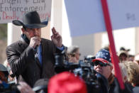 "FILE - In this Friday, Jan. 31, 2020 file photo, Otero County Commissioner Couy Griffin speaks in Santa Fe, N.M., during a gun rights rally. Griffin, who founded the group ""Cowboys for Trump,"" entered the Capitol grounds in Washington on Jan. 6, 2021, then kept posting on Parler about his support for continuing the fight and told his fellow county commissioners that he planned to attend the inauguration armed. (AP Photo/Morgan Lee)"