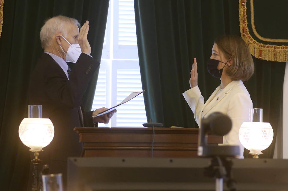 In this Thursday, Jan. 7, 2021, photo provided by the Vermont Lieutenant Governor's Office, U.S. Court of Appeal Judge Peter Hall, left, administers the oath of office to Lt. Gov. Molly Gray at the State House in Montpelier, Vt. Hall, on the 2nd Circuit U.S. Court of Appeals in New York, died Thursday, March 11, at the Rutland Regional Medical Center in Rutland, Vt. He was 72. (Samantha Sheehan/Vermont Lieutenant Governor's Office, via AP)