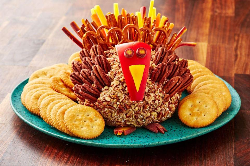 "<p>Every single part of this turkey cheese ball is edible, so consider the appetizer a shoe-in for this year's spread. </p><p>Get the recipe from <a href=""https://www.delish.com/holiday-recipes/thanksgiving/a29167451/turkey-cheese-ball-recipe/"" rel=""nofollow noopener"" target=""_blank"" data-ylk=""slk:Delish"" class=""link rapid-noclick-resp"">Delish</a>.</p>"