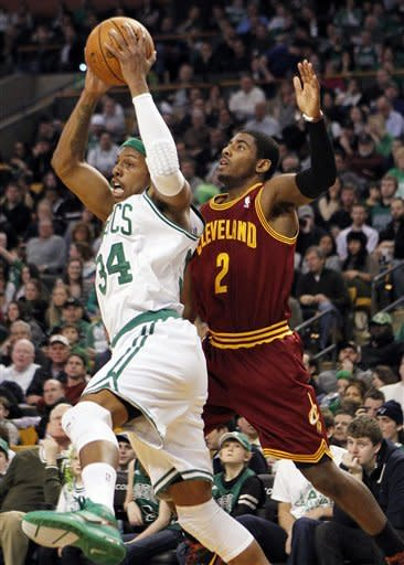 Boston Celtics' Paul Pierce (34) grabs a high pass in front of Cleveland Cavaliers' Kyrie Irving (2) in the second quarter of an NBA basketball game in Boston, Sunday, Jan. 29, 2012. (AP Photo/Michael Dwyer)