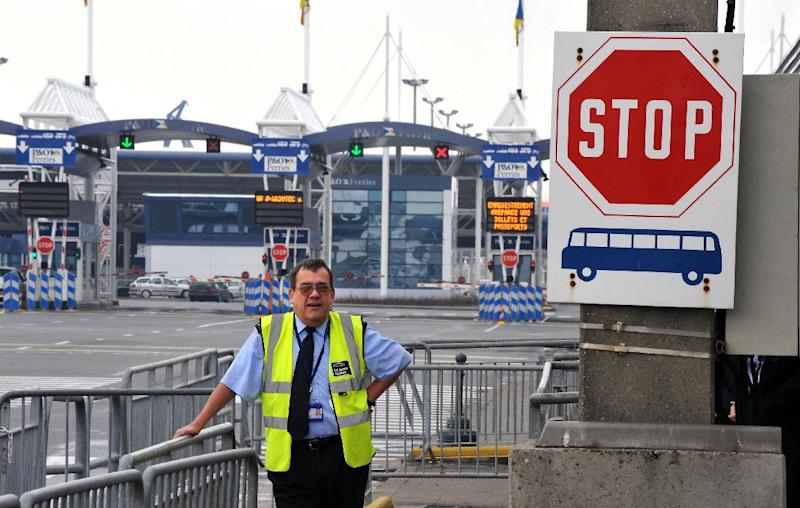 A member of the UK Border agency stands at the entrance of the Channel Ferries in Calais, northern France, on January 27, 2009 (AFP Photo/Philippe Huguen)