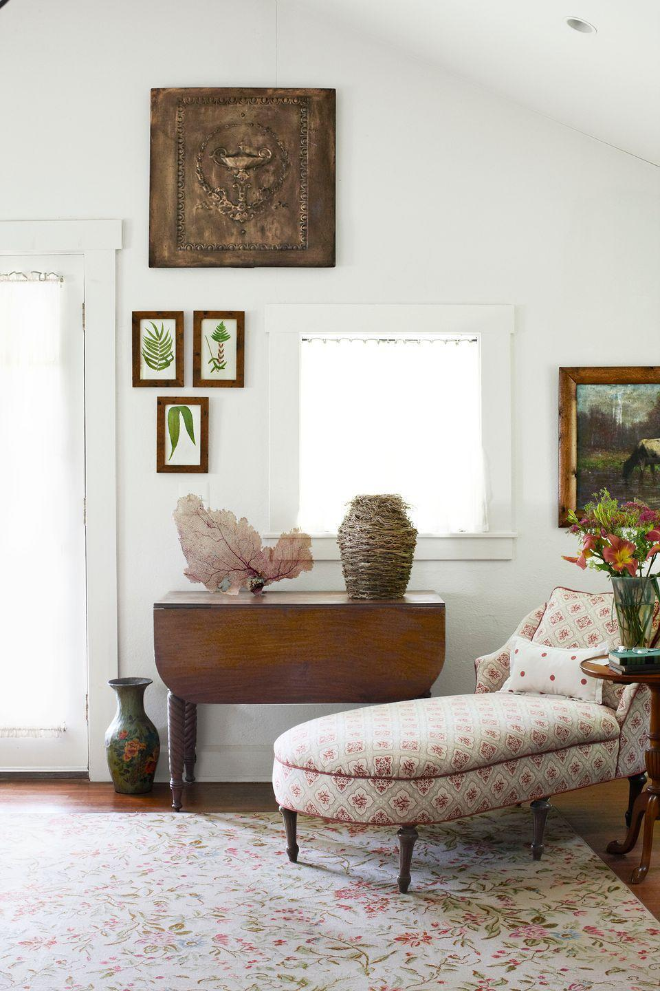 <p>A floral patterned chaise and area rug bring a sophisticated elegance to this reading space. </p>