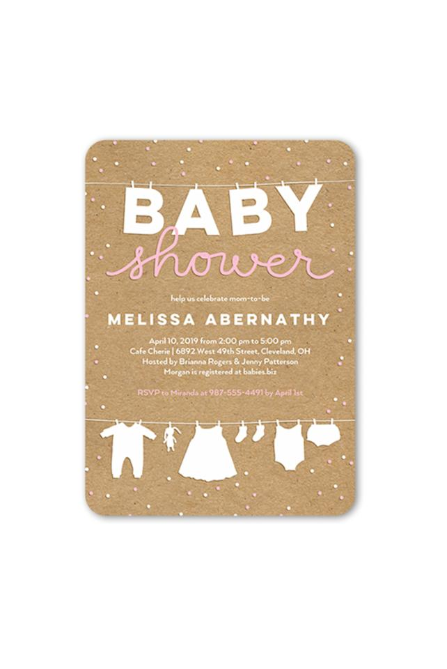 """<p><strong>SFLY</strong></p><p>shutterfly.com</p><p><strong>$132.00</strong></p><p><a rel=""""nofollow"""" href=""""https://www.shutterfly.com/cards-stationery/baby-shower-invitations/cute-linens-girl-baby-shower-invitation-5x7-flat"""">SHOP NOW</a></p><p> This clothesline invitation is both simple and sweet. </p>"""