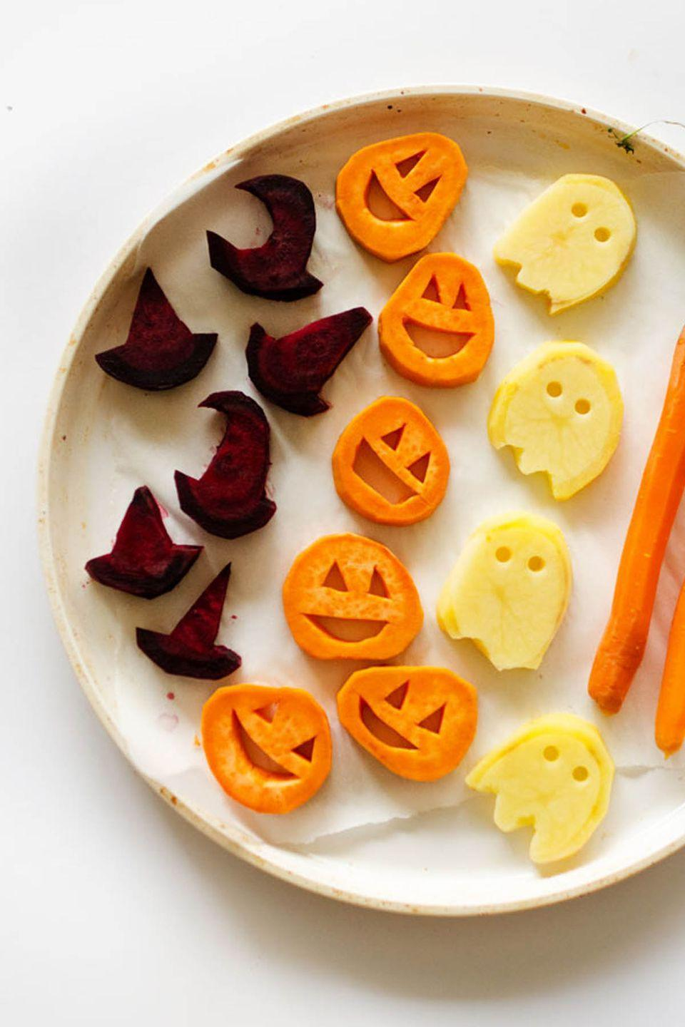"<p>Even the pickiest of eaters won't be able to resist a bite of these <a href=""https://www.womansday.com/food-recipes/food-drinks/g2500/halloween-snacks/"" rel=""nofollow noopener"" target=""_blank"" data-ylk=""slk:super-cute snacks"" class=""link rapid-noclick-resp"">super-cute snacks</a>. <br></p><p><strong>Get the recipe at <a href=""http://www.liveeatlearn.com/halloween-roasted-vegetables/"" rel=""nofollow noopener"" target=""_blank"" data-ylk=""slk:Live Eat Learn"" class=""link rapid-noclick-resp"">Live Eat Learn</a>.</strong></p>"