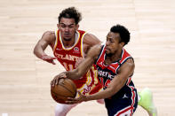 Atlanta Hawks guard Trae Young (11) tries to steal the ball from Washington Wizards guard Ish Smith (14) as they come down court during the second half of an NBA basketball game Wednesday, May 12, 2021, in Atlanta. Atlanta Hawks defeated the Washington Wizards 120-116. (AP Photo/Butch Dill)