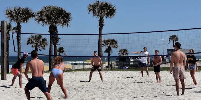 Spring breakers play volleyball during a spring break at Daytona Beach after Florida Governor Ron DeSantis refused to order the state's beaches closed as the number of COVID-19 cases increases across the state.