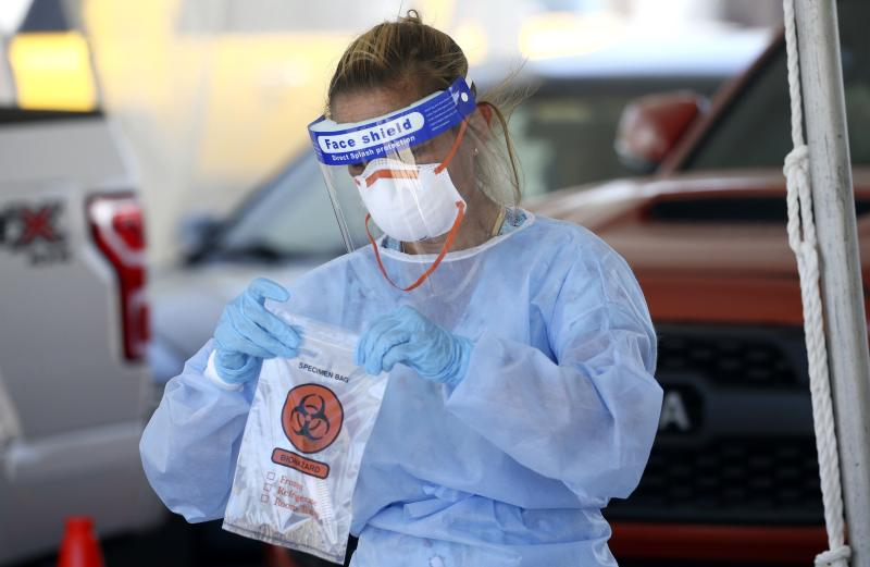 A specimen is secured at a drive-thru coronavirus testing site at South Mountain Community College on July 9, 2020, in Phoenix. (Ross D. Franklin/AP)