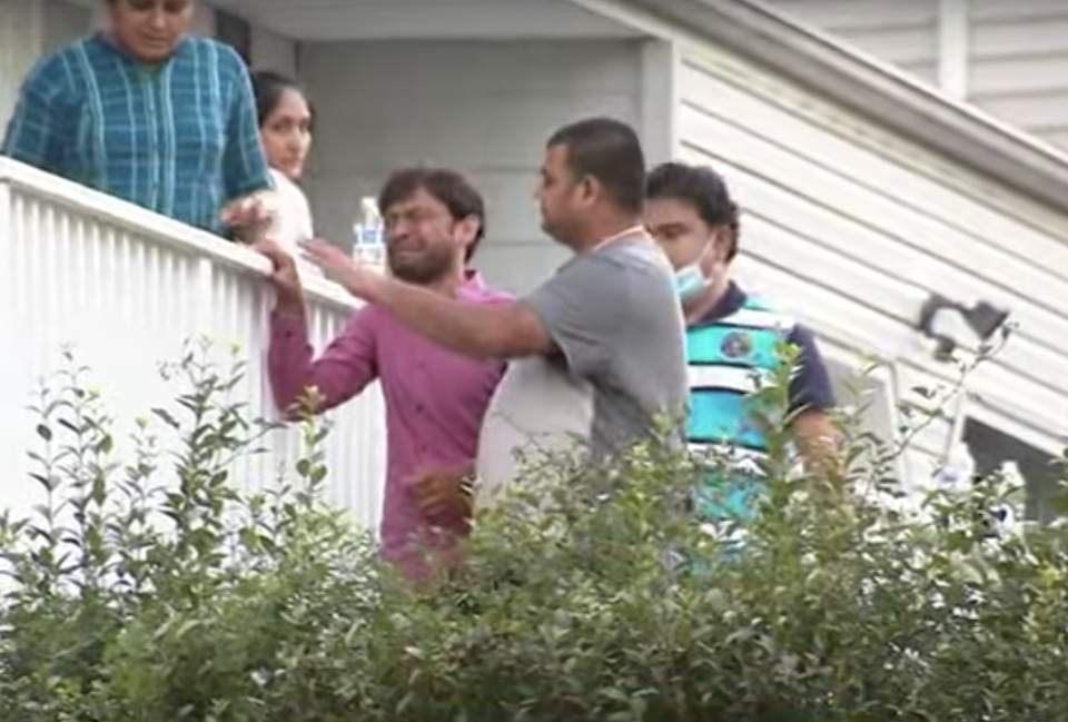 Family members cry outside a New Jersey home after three people drowned.