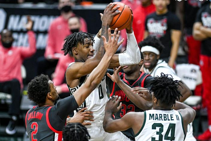 Michigan State's Aaron Henry pulls down a rebound against Ohio State during the second half on Thursday, Feb. 25, 2021, at the Breslin Center in East Lansing.